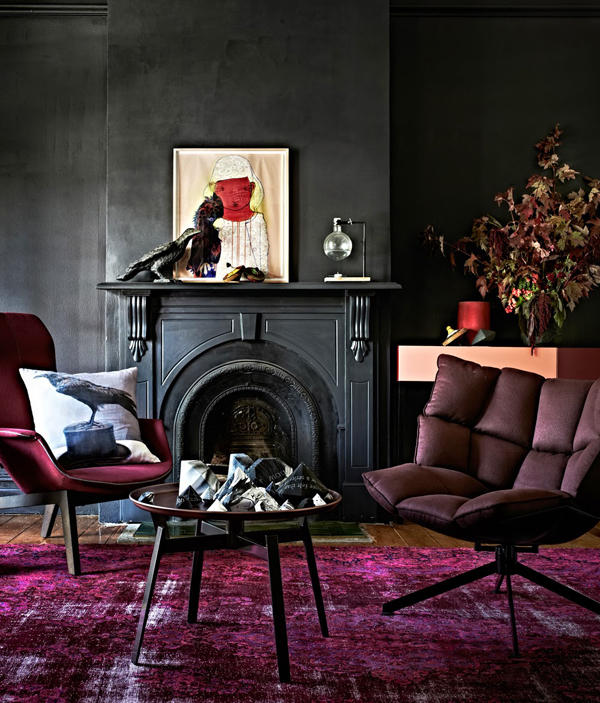 A Black Victorian Living Room With Luxurious Plum-Colored Furnishings
