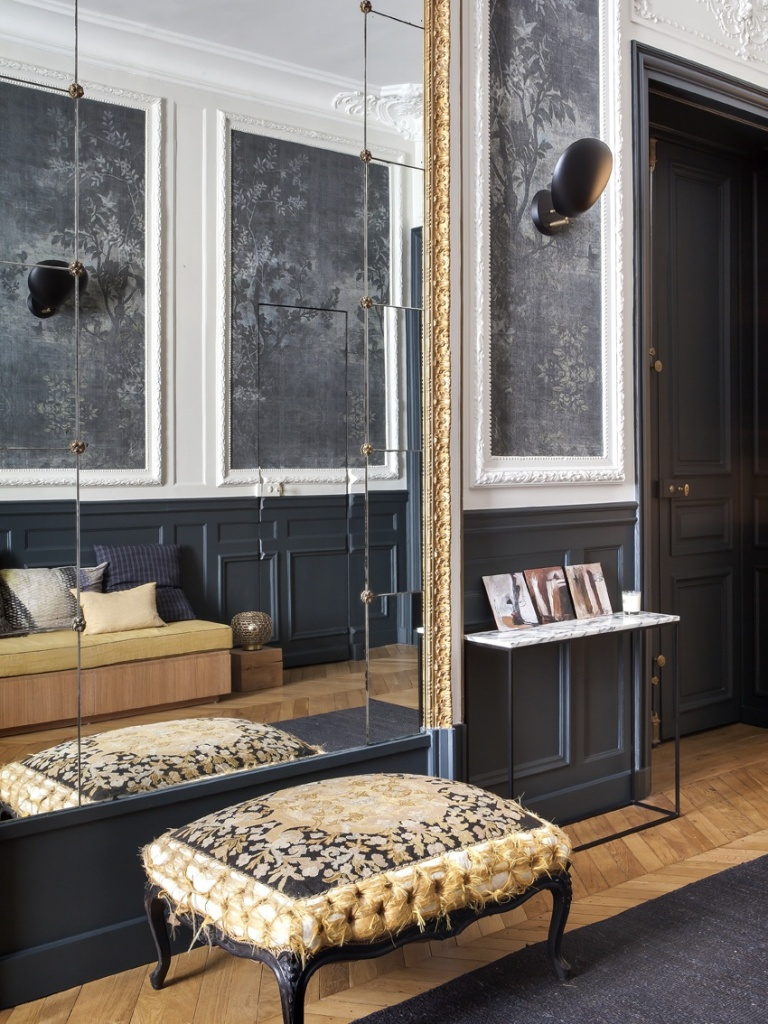 A Parisian Living Room With Dramatic Patterns and Metallic Accents