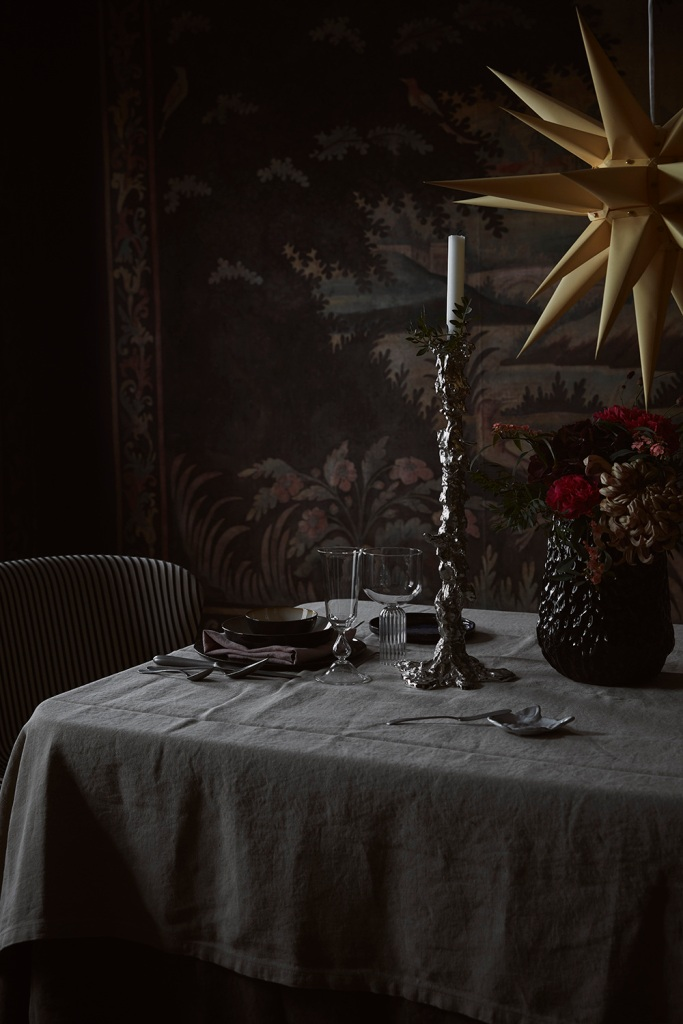simple, minimalist scandinavian christmas ideas: use candlesticks and simple floral arrangements in lieu of a centerpiece